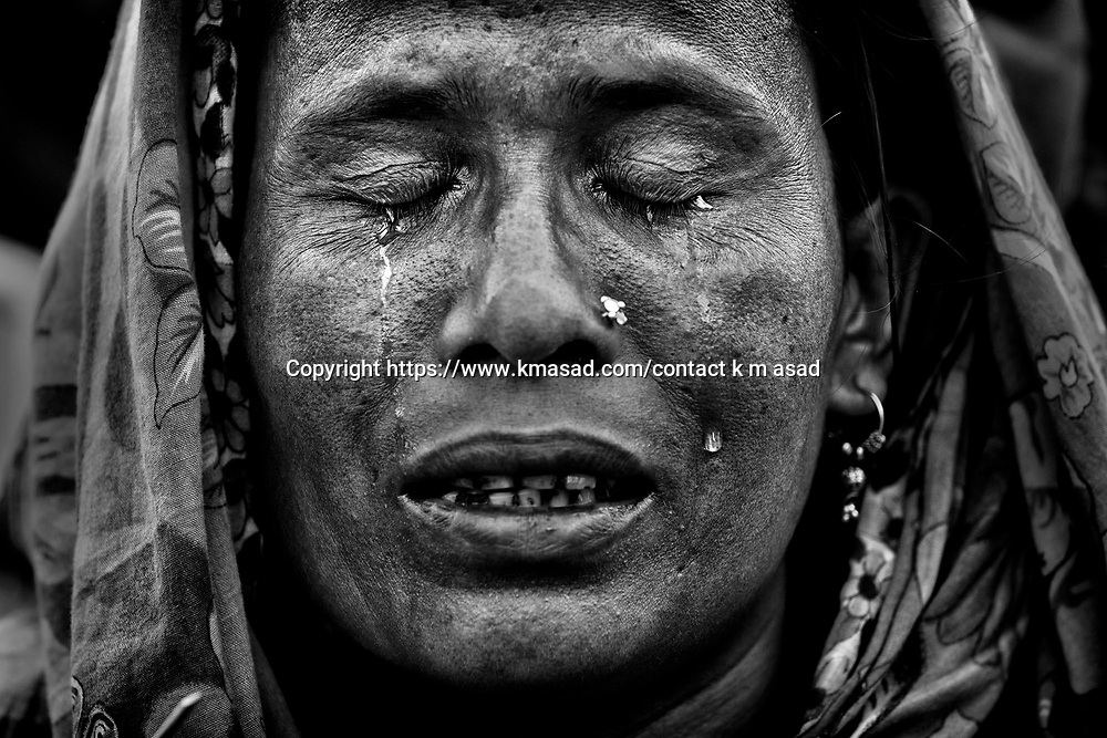 1-13.Relatives of victims take part in a special prayer near the damaged site after the end of the rescue work after 20 days following the Rana Plaza building collapsed in Savar, Dhaka, Bangladesh on 14 May 2013.