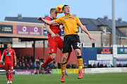 York City defender, on loan from Burnley, Luke Hendrie wins the header against Newport County midfielder, on loan from Crystal Palace, Connor Dymond  during the Sky Bet League 2 match between York City and Newport County at Bootham Crescent, York, England on 16 January 2016. Photo by Simon Davies.