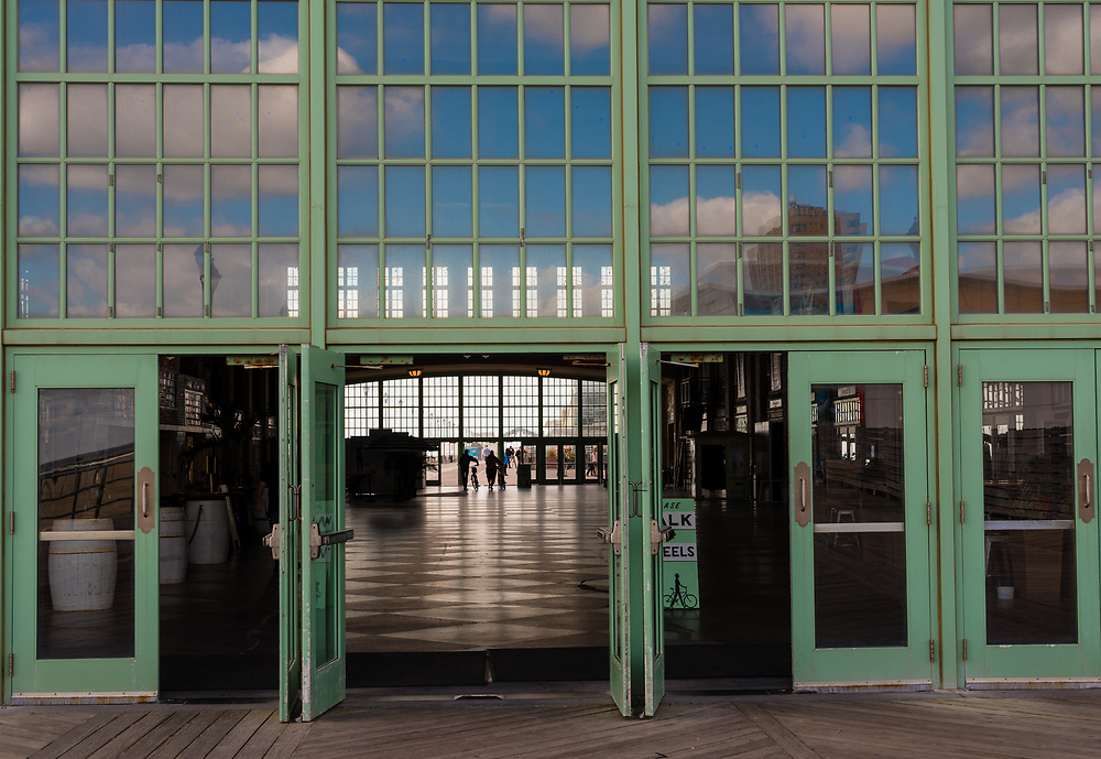 Asbury Park, NJ USA Oct 3, 2017 -- The doors are open to convention hall. Reflections of sky in windows above doors. Editorial Use Only.