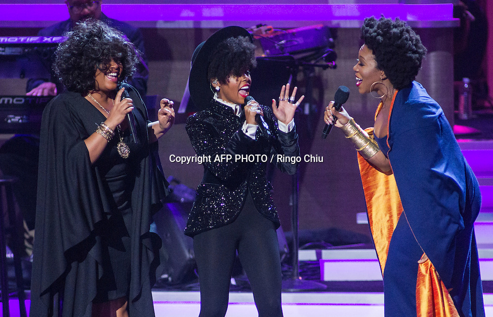 Jill Scott, left, Janelle Monae, center, and India.Arie perform at a concert, Stevie Wonder: Songs In The Key Of Life - An All-Star GRAMMY Salute, at Nokia Theatre L.A. Live on February 10, 2015 in Los Angeles, California. AFP PHOTO / Ringo Chiu