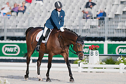 Jens Lasse Dokkan riding Heiberg in the Grade 1a Para-Dressage at the 2014 World Equestrian Games, Caen, Normandy, France..