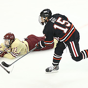Kevin Roy #15 of the Northeastern Huskies shoots a puck past Johnny Gaudreau #13 of the Boston College Eagles during The Beanpot Championship Game at TD Garden on February 10, 2014 in Boston, Massachusetts. (Photo by Elan Kawesch)