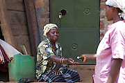 Nusula Ssewanonda (left) is a member of Kirangira Womens group in Mukono District, Uganda. She recently sold a bull calf and has invested the money in drainpipes and a big water tank. She now collects rainwater from the roof of her house and sells it to people in her village. She then used this money to install bio gas.