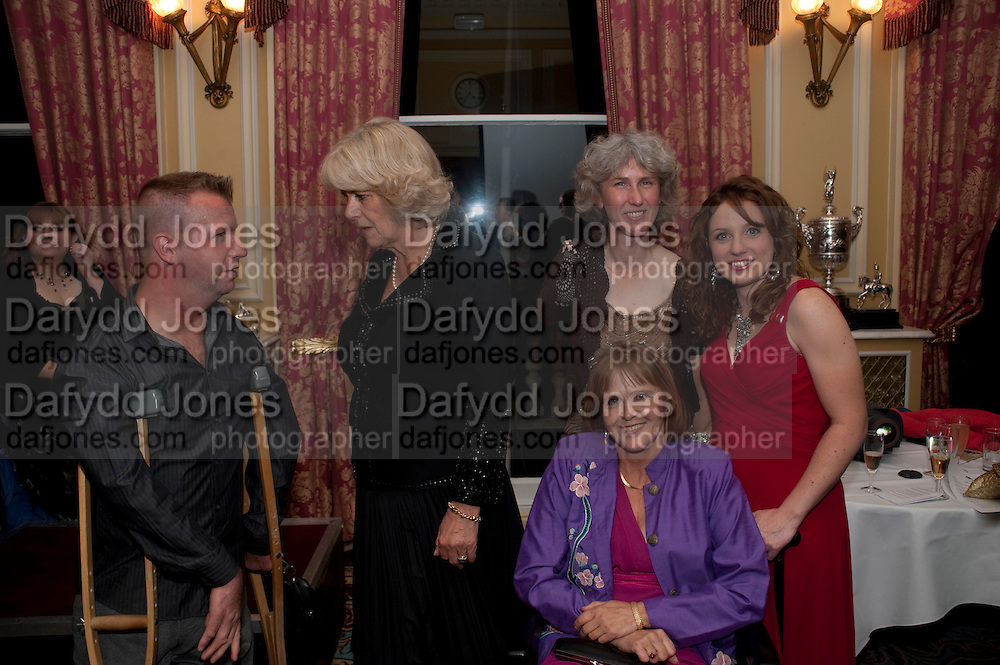 LEE PEARSON;  CAMILLA DUCHESS OF CORNWALL;DEBORAH CRIDDLE;  ANNE DUNHAM; NATASHA BAKER;, The Lady Joseph Trust, fundraising party.<br /> Camilla, Duchess of Cornwall  attends gala fundraising event as newly appointed President of the charity. The Lady Joseph Trust was formed in 2009 to raise funds to acquire horses for the UKÕs top Paralympic riders Cavalry and Guards Club, 127 Piccadilly, London,<br /> 26 October 2011. <br /> <br />  , -DO NOT ARCHIVE-© Copyright Photograph by Dafydd Jones. 248 Clapham Rd. London SW9 0PZ. Tel 0207 820 0771. www.dafjones.com.<br /> LEE PEARSON;  CAMILLA DUCHESS OF CORNWALL;DEBORAH CRIDDLE;  ANNE DUNHAM; NATASHA BAKER;, The Lady Joseph Trust, fundraising party.<br /> Camilla, Duchess of Cornwall  attends gala fundraising event as newly appointed President of the charity. The Lady Joseph Trust was formed in 2009 to raise funds to acquire horses for the UK's top Paralympic riders Cavalry and Guards Club, 127 Piccadilly, London,<br /> 26 October 2011. <br /> <br />  , -DO NOT ARCHIVE-© Copyright Photograph by Dafydd Jones. 248 Clapham Rd. London SW9 0PZ. Tel 0207 820 0771. www.dafjones.com.