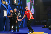 Mark Webster celebrates defeating Mensur Suljovic in the second round during the William Hill World Darts Championship at Alexandra Palace, London, United Kingdom on 27 December 2016. Photo by Shane Healey.