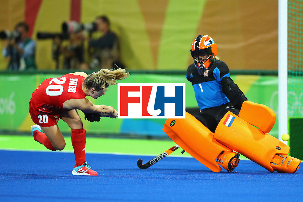 RIO DE JANEIRO, BRAZIL - AUGUST 19:  Hollie Webb of Great Britain scores the winning penalty goal past Joyce Sombroek of Netherlands during the Women's Gold Medal Match on Day 14 of the Rio 2016 Olympic Games at the Olympic Hockey Centre on August 19, 2016 in Rio de Janeiro, Brazil.  (Photo by Tom Pennington/Getty Images)