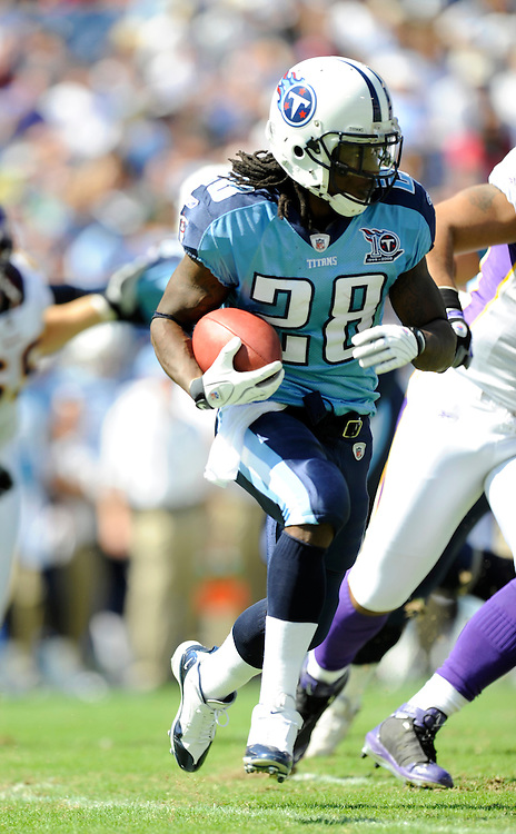 NASHVILLE - SEPTEMBER 28: Chris Johnson #28 of the Tennessee Titans rushes against the Minnesota Vikings on September 28, 2008 at LP Stadium in Nashville, Tennessee. The Titans defeated the Vikings by a score of 30 to 17. *** Local Caption *** Chris Johnson