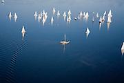 Nederland, Zuid-Holland, Roelofsarendsveen, 11-02-2008; Braassemermeer, zeilboten op een zonnige en winterse zondagmiddag, de zeiljachten worden vergezeld door een platbodem; blauw water, wind, varen, Bra*s*e*mermeer, zeilboot, plas, zeilen, zeil, recreatie.  .luchtfoto (toeslag); aerial photo (additional fee required); .foto Siebe Swart / photo Siebe Swart