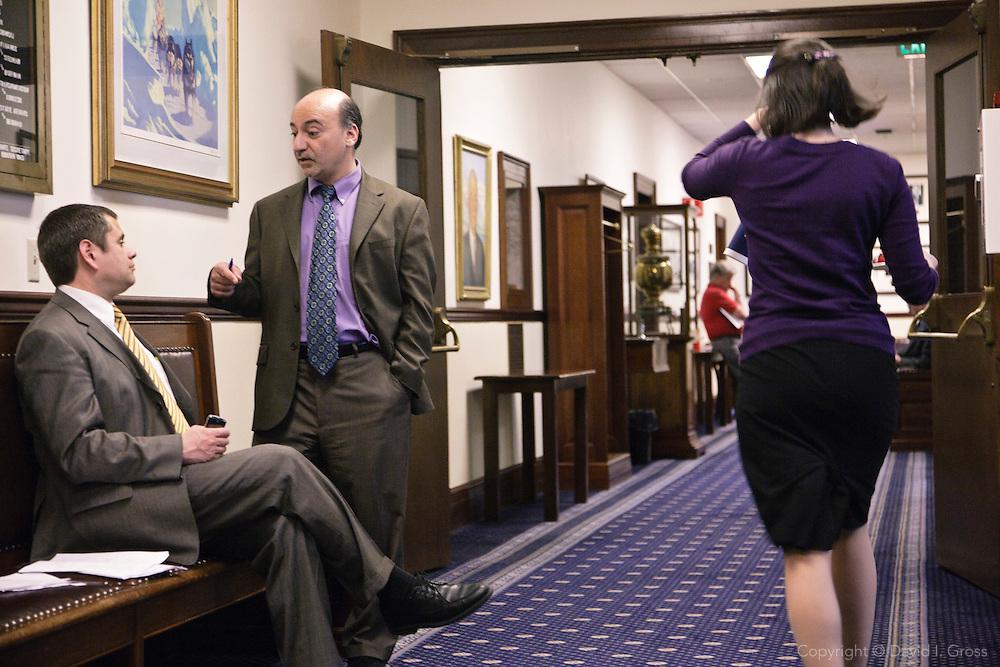 Representatives Chris Tuck(D) (seated) chats with Les Gara (D) in the Alaska State Legislature.