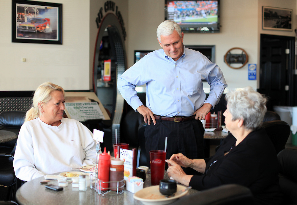 Indiana Republican candidate for Governor Mike Pence talks to Beth Adams, left, and Carolyn Lincks during a campaign stop at the Pit Stop BBQ and Grill in Brownsburg, Ind. Monday Oct. 15. .Chris Bergin/ for The Republic