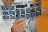 Dentist and Patient Examining X-rays