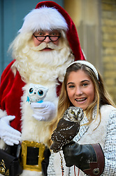 "© Licensed to London News Pictures. 13/11/2019. LONDON, UK. Santa, an Owleez owl by Spin Master Toys, Rosie (aged 13) and a live Tengleman's owl at the preview of ""DreamToys"", the official toys and games Christmas Preview, held at St Mary's Church in Marylebone.  Recognised as the countdown to Christmas, the Toy Retailer's Association, an independent panel of leading UK toy retailers, have selected the definitive and most authoritative list of which toys will be the hottest property this Christmas..  Photo credit: Stephen Chung/LNP"