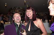 Graham Norton and Janet Street-Porter. Talk pre-Bafta party. St. Martin's Lane Hotel. London. 24 February 2001. © Copyright Photograph by Dafydd Jones 66 Stockwell Park Rd. London SW9 0DA Tel 020 7733 0108 www.dafjones.com