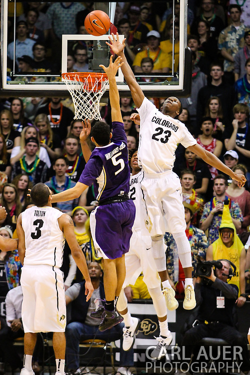 February 9th, 2014:  Colorado Buffaloes freshman guard Jaron Hopkins (23) attempts to block the shot by Washington Huskies freshman guard Nigel Williams-Goss (5) in the second half of action in the NCAA Basketball game between the Washington Huskies and the University of Colorado Buffaloes at the Coors Events Center in Boulder, Colorado