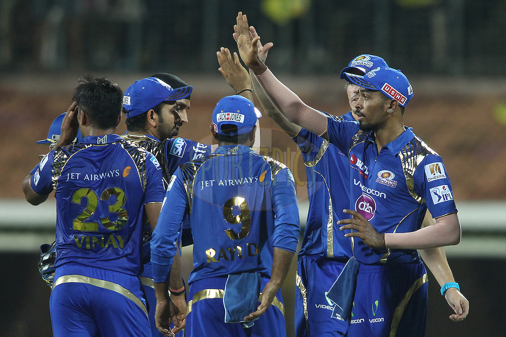 Mumbai Indians captain Rohit Sharma congratulates Hardik Pandya of Mumbai Indians for taking the catch to get Brendon McCullum of Chennai Super Kings wicket during match 43 of the Pepsi IPL 2015 (Indian Premier League) between The Chennai Super Kings and The Mumbai Indians held at the M. A. Chidambaram Stadium, Chennai Stadium in Chennai, India on the 8th May April 2015.<br /> <br /> Photo by:  Shaun Roy / SPORTZPICS / IPL