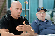 Ken Keene Jr. (left) and his father Ken Keene Sr. sit on the patio as they chat about living with early onset dementia Thursday, August 31, 2017 at the Delaware Valley Veterans Home in Philadelphia, Pennsylvania. (WILLIAM THOMAS CAIN / For The Philadelphia Inquirer)