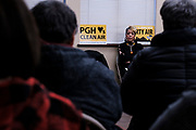 Cheryl Hurt looks on as environmental advocates and residents of Mon Valley towns express concern and anger about emissions from U.S. Steel's Clairton Plant at a public forum in Clairton, Pa.<br /> <br /> Cheryl Hurt keeps an air quality monitor in her day-care center that she runs out of her home in Clairton, Pa. Along with John Marcus, from nearby Jefferson Hills, Hurt has sued U.S. Steel over emissions from the quenching towers of its Clairton Works coke plant. The lawsuit, claims that the U.S. Steel plant has not reduced its toxic emissions and as a result, children need to use inhalers while playing sports because of asthma.