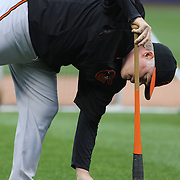 Buck Showalter the Baltimore Orioles Manager collecting baseballs during batting practice before the New York Mets Vs Baltimore Orioles MLB regular season baseball game at Citi Field, Queens, New York. USA. 5th May 2015. Photo Tim Clayton