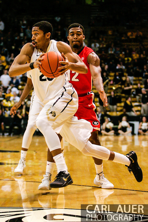 December 28th, 2013:  Colorado Buffaloes junior guard Spencer Dinwiddie (25) drives towards the basket in the second half of the NCAA Basketball game between the Georgia Bulldogs and the University of Colorado Buffaloes at the Coors Events Center in Boulder, Colorado