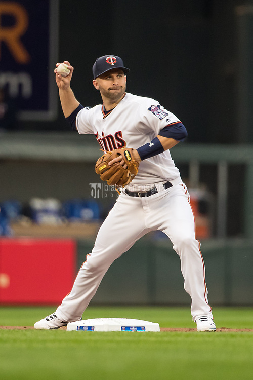 MINNEAPOLIS, MN- APRIL 3: Brian Dozier #2 of the Minnesota Twins throws against the Kansas City Royals on April 3, 2017 at Target Field in Minneapolis, Minnesota. The Twins defeated the Royals 7-1. (Photo by Brace Hemmelgarn) *** Local Caption *** Brian Dozier