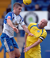 Photo: Paul Greenwood.<br />Bury FC v Wycombe Wanderers. Coca Cola League 2. 17/02/2007. Bury's Dave Challinor, left beats Wycombe's Tommy Mooney in the air