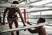 Bangkok  March 2014, Inmates during a Muay Thai (kickboxing) training session at the Klong Prem high-security prison.  Klong-prem Central Prison, or generally called Lad-yao prison, is a high-security prison in Bangkok, taking in custody of male offenders whose sentence term is not over 25 years. With its general capacity to incarcerate offenders (5000+), the prison currently takes in custody of both Thai and foreign nationals. <br /> The inmates is part of a program that pits prisoners against foreign Muay Thai fighters or others inmates for a chance of reduced sentencing or early release. In 2012 an Estonian entrepreneur, in conjunction with Thailand's Department of Corrections, began a series of bouts arranged between Thai prisoners and Western Muay Thai fighters under the banner 'Prison Fight'. For the prisoners a victory holds the potential of time off their sentence while the Westerners fight for a small purse and personal ambition. Since the launch of 'prison fight' a number of prisons have adopted the idea, encouraging prisoners to take up boxing to fight drug abuse and to give them a purpose while incarcerated.Bangkok  Mars 2014, <br /> Des détenus lors d'une séance de formation au Muay Thai (kickboxing) à la prison de haute sécurité de Klong Prem. La prison centrale de Klong-prem, ou prison de Lad-yao, est une prison de haute sécurité de Bangkok qui accueille en détention des délinquants de sexe masculin dont la peine ne dépasse pas 25 ans. Avec sa capacité générale d'incarcération des délinquants (plus de 5 000), la prison accueille actuellement des ressortissants thaïlandais et étrangers en détention. <br /> Les détenus font parties d'un programme qui oppose les détenus à des combattants étrangers du Muay Thai ou à d'autres détenus pour obtenir une réduction de peine ou une libération anticipée. En 2012, un entrepreneur estonien, en collaboration avec le Département de l'administration pénitentiaire thaïlandais, a lancé une série de comb