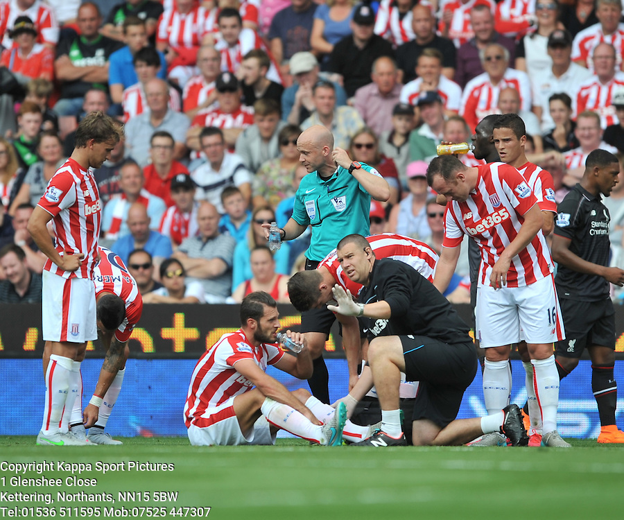 STOKE ERIK PIETERS RECIEVES TREATMENT AFTER HIS COLLISION WITH LIVERPOOLS JORDAN IBE, Stoke City v Liverpool, Premiership, Britannia Stadium Sunday 9th August 2015