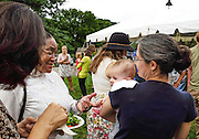 First Lady Deborah McDavis greets the child of the new Assistant Director of the Child Development Center, Kristin Mazzeo Barron at the annual garden  party. Photo Courtesy of Bob Klein