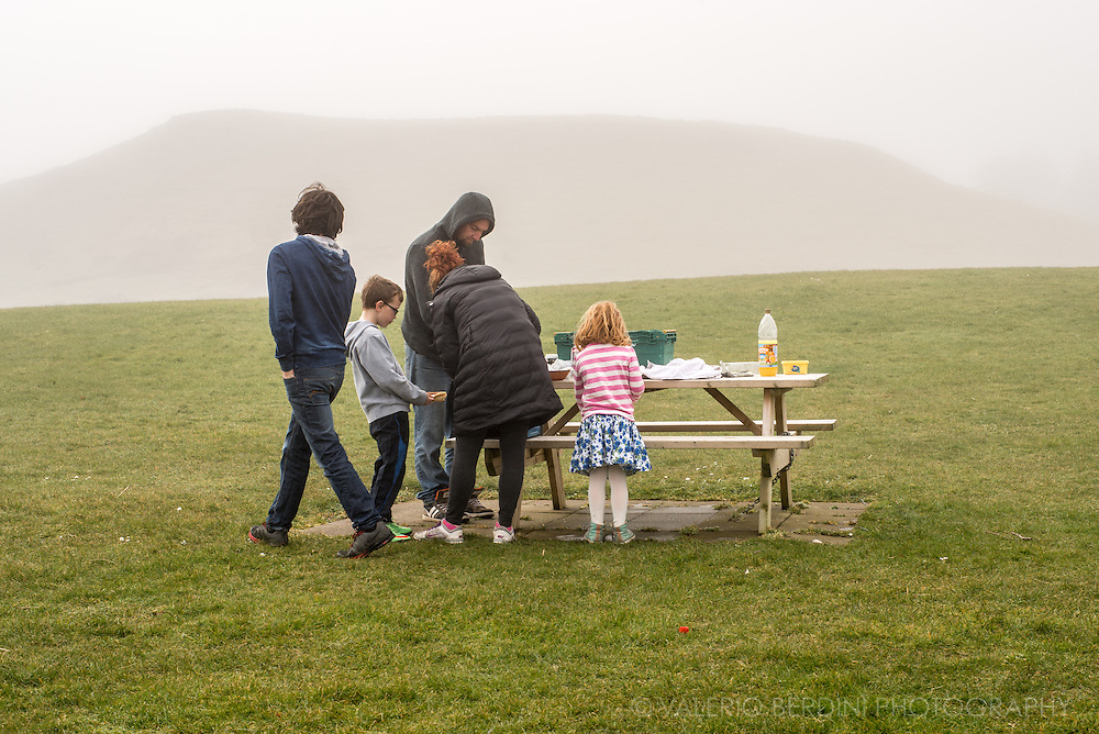 Despite the mist, a family enjoys a picnic along the scenic route heading to the Giant's Causeway. Northern Irish people love outdoor activities.
