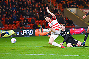 Andrew Butler of Doncaster Rovers (6) comes close to connecting with a cross during the EFL Sky Bet League 1 match between Doncaster Rovers and Barnsley at the Keepmoat Stadium, Doncaster, England on 15 March 2019.