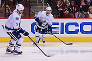 Nov 5, 2013; Glendale, AZ, USA; Vancouver Canucks defensemen Ryan Stanton (18) and defensemen Kevin Bieksa (3) skates in the second period against the Phoenix Coyotes at Jobing.com Arena. The Coyotes defeated the Canucks 3-2 in an overtime shoot out. Mandatory Credit: Jennifer Stewart-USA TODAY Sports