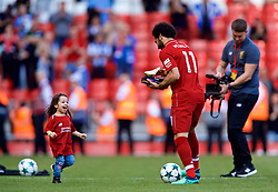 LIVERPOOL, ENGLAND - Sunday, May 13, 2018: Liverpool's Mohamed Salah shares a kick about with his daughter Makka after receiving the Premier League Golden Boot trophy for finishing the season as the leading League goal-scorer with 32 goals after the FA Premier League match between Liverpool FC and Brighton & Hove Albion FC at Anfield. Liverpool won 4-0 and finished 4th. (Pic by David Rawcliffe/Propaganda)