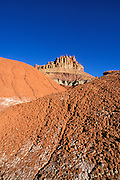 Morning light on the Castle and eroded hills of the Waterpocket Fold near Fruita, Capitol Reef National Park, Utah
