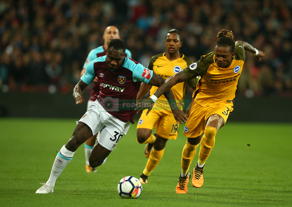 October 20, 2017 - London, England, United Kingdom - West Ham United's Michail Antonio takes on Brighton & Hove Albion's Gaetan Bong.during Premier League match between West Ham United against Brighton and Hove Albion at The London Stadium, Queen Elizabeth II Olympic Park, London, Britain - 20 Oct  2017  (Credit Image: © Kieran Galvin/NurPhoto via ZUMA Press)