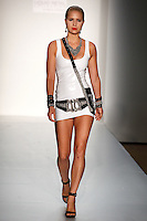 A Model walks the runway wearing Liquid Metal Spring 2010 during Mercedes-Benz Fashion Week in New York, NY on September 11, 2009