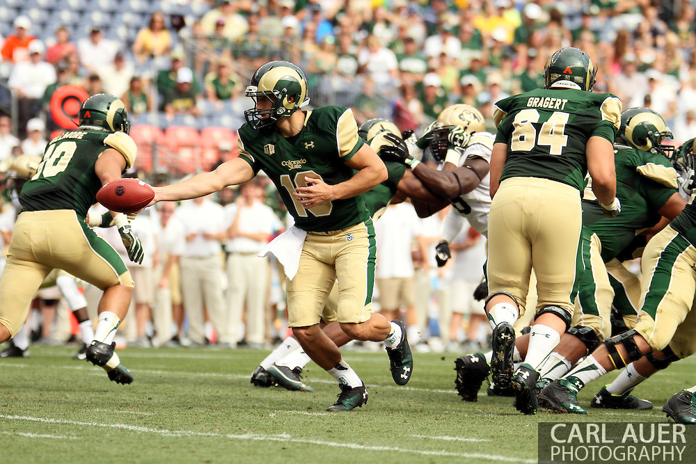 September 1st, 2013 - Colorado State Rams junior quarterback Garrett Grayson (18) fakes a hand off in the first half of the NCAA football game between the Colorado Buffaloes and the Colorado State Rams at Sports Authority Field in Denver, CO