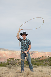 cowboy swinging a lasso over his head