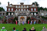 Old Westbury, New York, USA. 28th June 2015. Lori Belilove & The Isadora Duncan Dance Company, dressed in Renaissance themed tunics, perform on the South Lawn in front of the Mansion of historic Old Westbury Gardens, a Long Island Gold Coast estate, for its Midsummer Night event.