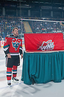 KELOWNA, CANADA - SEPTEMBER 20: Colten Martin #8 of Kelowna Rockets stands beside the BC Division Championship banner at the Kelowna Rockets raise it during the home opener against the Kamloops Blazers on September 20, 2014 at Prospera Place in Kelowna, British Columbia, Canada.   (Photo by Marissa Baecker/Shoot the Breeze)  *** Local Caption *** Colten Martin;