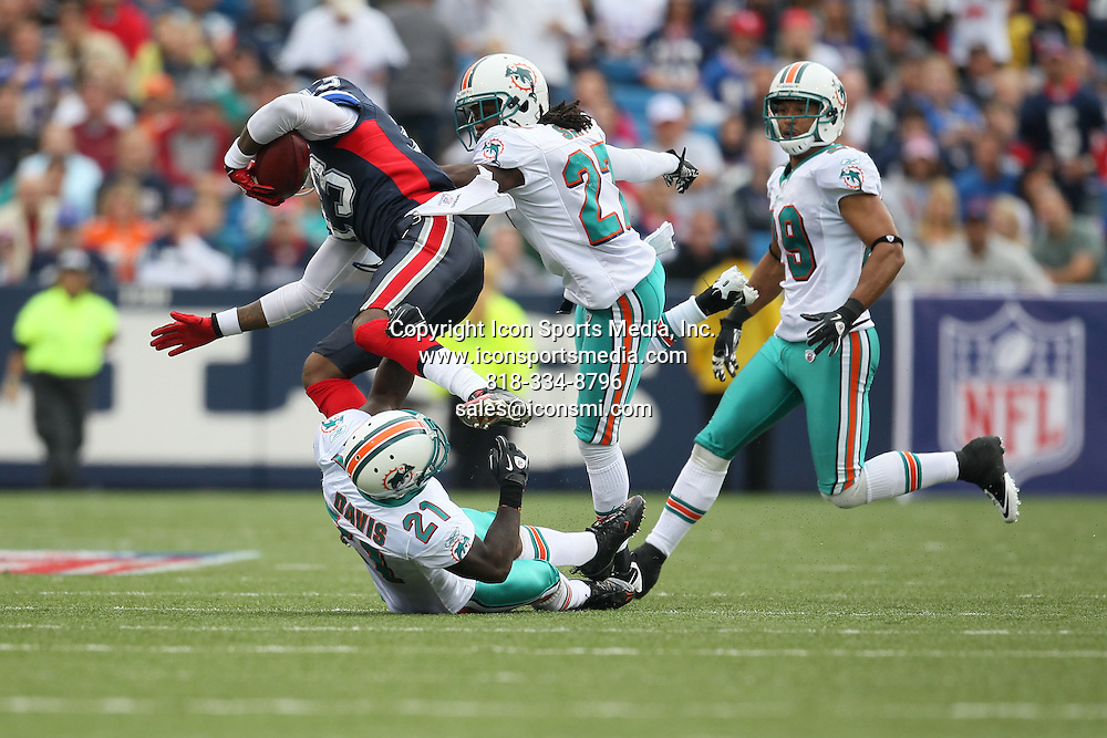 12 September 2010: Buffalo Bills wide receiver Steve Johnson (13) is tackled by Miami Dolphins defensive back Benny Sapp (27) and cornerback Vontae Davis (21).  The Miami Dolphins defeated the Buffalo Bills by a score of 15 to 10 at Ralph Wilson Stadium, Orchard Park, NY.