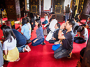 29 DECEMBER 2013 - BANGKOK, THAILAND:   People pray for the Patriarch at Wat Bowon Niwet in Bangkok. Somdet Phra Nyanasamvara, who headed Thailand's order of Buddhist monks for more than two decades and was known as the Supreme Patriarch, died Oct. 24 at a hospital in Bangkok. He was 100. He was ordained as a Buddhist monk in 1933 and rose through the monastic ranks to become the Supreme Patriarch in 1989. He was the spiritual advisor to Bhumibol Adulyadej, the King of Thailand when the King served as monk in 1956. There is a 100 day mourning period for the Patriarch. Although the Patriarch was a Theravada Buddhist, he was the Supreme Patriarch of all Buddhists in Thailand, including the Mahayana sect, which is based on Chinese Buddhism.        PHOTO BY JACK KURTZ