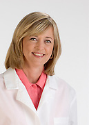 Woman healthcare worker on white background.  Shot for Oticon.