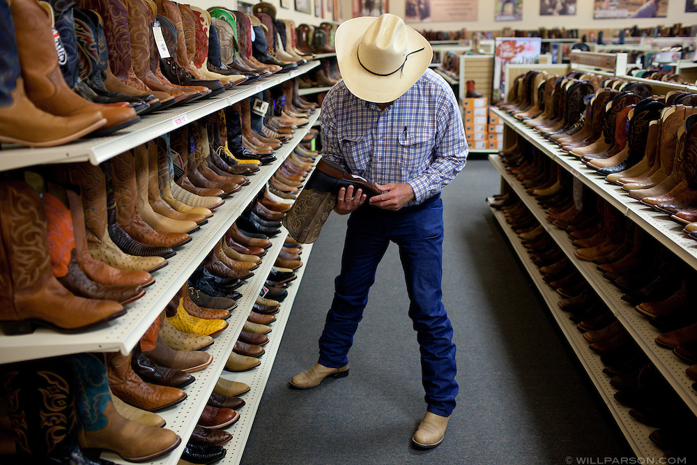 J Parson shops for boots in Pittsburg, Kansas.