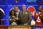 Philadelphia Eagles wide receiver James Thrash appears with show host Pat Sajak and a contestant at NFL Players Week on Wheel of Fortune on 11/04/2003. ©Paul Anthony Spinelli/NFL Photos
