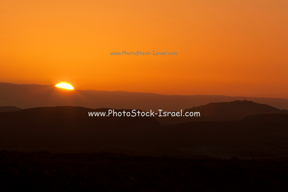 Sunset at Ramon Crater, the world's largest karst erosion cirque, at the peak of Mount Negev in Israel