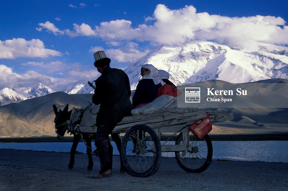 Kirghiz people traveling on Karakorum Highway with Karakuli Lake and Mt. Kunlun in the distance, Pamir Plateau, Xinjiang Province, Silk Road, China