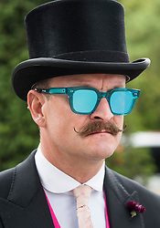 © Licensed to London News Pictures. 19/06/2018. London, UK.  A racegoer with an elaborate moustache and glasses  attends day one of Royal Ascot at Ascot racecourse in Berkshire, on June 19, 2018. The 5 day showcase event, which is one of the highlights of the racing calendar, has been held at the famous Berkshire course since 1711 and tradition is a hallmark of the meeting. Top hats and tails remain compulsory in parts of the course. Photo credit: Ben Cawthra/LNP