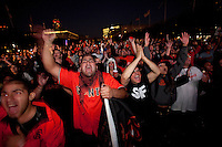 SAN FRANCISCO, CA - NOV 1:  San Francisco Giants fans Miguel Ochoa and Nicholas Renault react after watching Edgar Renteria hit a 3 run homerun in the 7th inning as the Giants defeat the Texas Rangers to win the World Series in 5 games at the Civic Center Plaza on November 1, 2010 in San Francisco, California.  The Giants won their first World Series in 56 years since moving to San Francisco from New York.  Photograph by David Paul Morris
