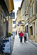 Tourists stroll in St Emilion in the Bordeaux region of France