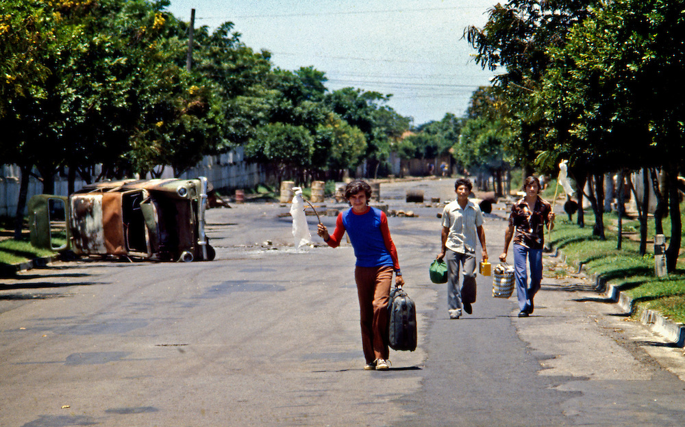 Young refugees of the Civil War in Nicaragua leave Leon with raised white flags of truce after government National Guard troops occupy the city during the 1978 civil war.